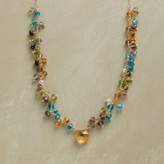 """MIRABELLA NECKLACE--Vivid multicolored hydro quartz rondelles, some suspended between links and others dangling freely. A festive flurry of gemstones hand wrapped with 14kt gold filled wire and graced with a glowing golden citrine. Handmade exclusively for us with lobster clasp. 18"""" to 20""""L."""