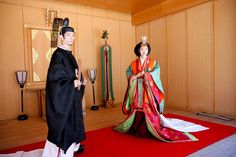 A couple wearing heian robes for a wedding.