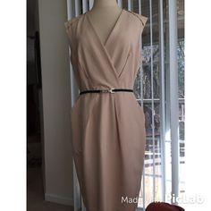 Ann Taylor Tan Dress Ann Taylor Tan Sleeveless Dress. This dress has it all- pockets- flattering v- neck, beautiful black belt and best of all; it's slimming. Size 10 Ann Taylor Dresses