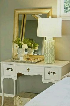 Chalk painted cream furniture, neautral walls and elegant hints of subtle gold. Classic, gorgeous desk/vanity table and nightstand.