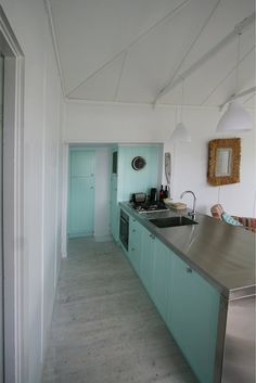 i love the simplicity and colour of this galley kitchen
