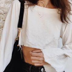 A clean take on a classic dolman top. Minimalist construction with no armhole seams, long sleeves, complemented by a high low hem and raw edges. Soft sand washed silk linen blend. - Sand Washed Silk/L