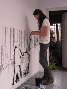 Debbie Smyth installing her exhibition, Threadbare.