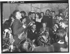 Washington, D.C. Pete Seeger, noted folk singer entertaining at the opening of the Washington labor canteen, sponsored by the United Federal Labor Canteen, sponsored by the Federal Workers of American, Congress of Industrial Organizations (CIO) (Picture shows First Lady Eleanor Roosevelt in audience) Date Feb 1944 .❤❁❤❁❤❁❤❁❤❁❤ http://www.fdrlibrary.marist.edu/aboutfdr/biographiesandmore.html  http://www.nps.gov/nr/travel/presidents/eleanor_roosevelt_valkill.html