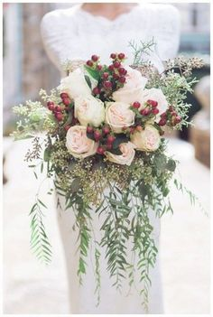 Wedding Flowers These pale pink roses and a red pop make this winter bouquet complete. - Flaunting flowers that are readily available in the season of your wedding will help you save big on a beautiful bouquet! Winter Wedding Flowers, Floral Wedding, Winter Weddings, Blue Wedding, Church Wedding, Elegant Wedding, Wedding Ceremony, Wedding Boquette, Berry Wedding