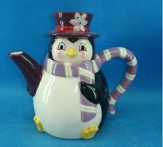 Penguin in Winter teapot ... scarf forming handle, wearing top hat with snowflake Christmas decoration, ceramic