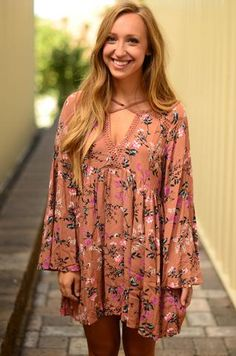 How cute is this dress for fall?!? It has an amazing rust, floral pattern that is sure to have you feeling ready for the season! Pair with some cute boots and a cardigan for the look you've always wan