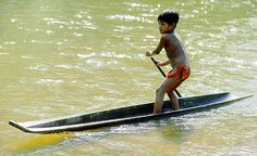 Colombia. Choco rain forest. Noanama Indian boy zipping over the Docordo River victorenglebertphotography