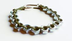 Men always enjoy wearing tough industrial style jewelry and this bracelet is no exception. Stainless steel hex nuts are lined up in a snake fashion for a tough look and then olive colored soft leather suede intertwine between them for a softer side we know all men have