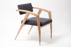 The front legs of this elegant, yet simple chair mimics the still movement of a Religious Mantis. The materials are Ash, small metal hardware and fabric.