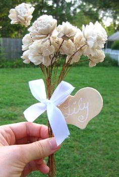 Flower girls personalized bouquet for country wedding with flowers and name.