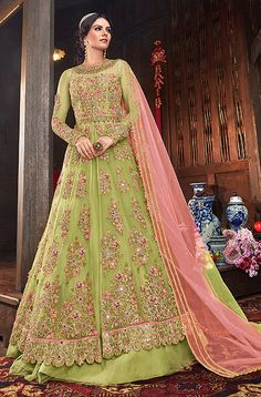 Green lehenga net fabric and pant art silk pant salwar suit. Designer indo western suit with two bottom,in green color paired with green colored dupatta. its heavy embroidered top is fabricated on net paired with art silk lehenga and net dupatta. Costumes Anarkali, Anarkali Gown, Anarkali Suits, Green Lehenga, Silk Lehenga, Lehenga Skirt, Saree, Salwar Kameez, Western Lehenga