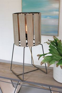 "Kalalou Wood Slatted Cylinder Tall Table Lamp -  Made from wood and raw metal, this industrial lighting piece stands at 30"" tall and is ideal for end tables but could also function as a floor lamp. It's slatted shade allows for a soft, relaxing glow, perfect for your living room or bedroom. 40w Edison bulb is not included."