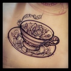 Tea cup, with pansies inside. This would make a really cool tattoo for coffee/tea lovers