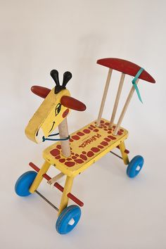 So why don't they make these anymore?   Hum , will work on a pattern to build--Vintage Playskool Wooden Giraffe Ride-On Toy by handmadecharlotte, via Flickr