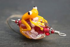 Yellow tree frog on flower bead