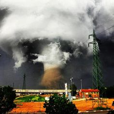 Beautiful picture of the tornado that hit northern Italy last week. - Imgur