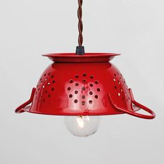 Red Colander Pendant - adorable enameled steel mini colander hangs upside down, completing its duty as a charming shade to this pendant light. The vintage inspiration continues in the brown, cloth-covered, twisted cord with a Bakelite plug. Hang it over your kitchen sink or inside the pantry. Available in other colors.
