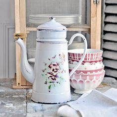 This is an early 1900s French enamelware coffee pot.paired with real French bowls.