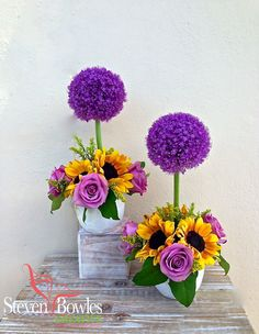Alliums topiary flower arrangement. Wedding topiary centerpieces in purple and yellow  wedding table decor of alliums and sunflowers. Designed by Steven Bowles Creative, Naples, Florida. www.stevenbowlescreative.com