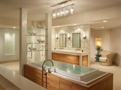 HGTVRemodels' Bathroom Planning Guide offers tips on how to design a bathroom layout around functional zones, such as the vanity and shower-tub area.
