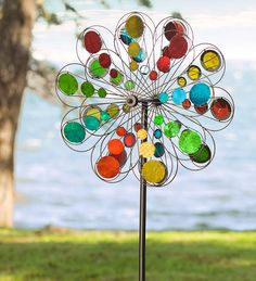 Our Multi-Colored Mirror Wind Spinner is a real kaleidoscope of colors, and, at more than six feet tall and two … Garden Wind Spinners, Wind Sculptures, Color Changing Lights, Green Butterfly, Colorful Garden, Mosaic Glass, Stained Glass, Yard Art, Wind Chimes