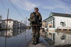 NEW ORLEANS, La. (Sept. 9, 2005) Staff Sgt. Karl Gatke, assigned to the 162 Infantry Division of the Oregon National Guard walks as far as he can into a flooded neighborhood Friday, Sept. 9, 2005 in the Jefferson Parish area of New Orleans, La. (Oscar Sosa/Bloomberg News)