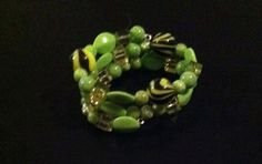Light Green, and Black Medium Memory Wire Bracelet. Please visit my facebook page called The Pelican By Kristin Maragrite. https://www.facebook.com/ThePelicanbyKristin/?ref=aymt_homepage_pane
