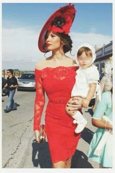Wedding guest in daring red. And not letting motherhood dampen the dramatic look!
