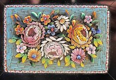 Very beautiful Grand Tour Era Souvenir. This Micro Mosaic paperweight is depicting a flower bouquet consisting of roses and flowers on a turquoise ground. c.1880