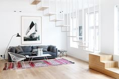 Two Spaces In A Building Transformed Into One Multi-Level Apartment