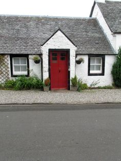 Residential home. Scotland. The red door adds so much character. Love this about the UK culture.
