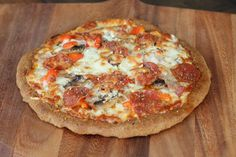Maria Emmerich's low-carb pizza crust. I made this! Would roll it out even thinner next time.