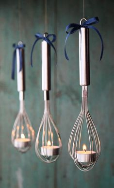 Whisk lantern candle holders made out of simple things you can find around the house.