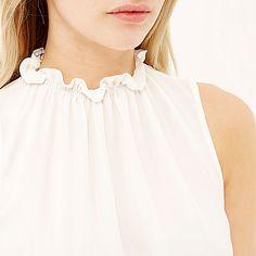 White ruched funnel neck bubble hem vest £24