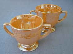 Pair of Anchor Hocking Fire King Peach Luster Sugar Bowls (perfect for small flower arrangements). $7.00, via Etsy.