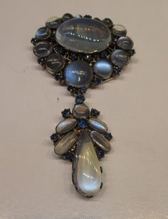 Dorrie Nossiter. Moonstone and sapphire dress clip with detachable dangle. Stunning! For sale by Markov (Mark Markov and Peter Beedles, PO Box 52819 London, SW11 4YW). View 2 of 6.