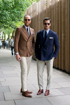 Fashion Stylist Joe Ottaway wearing a Gieves and Hawkes jacket with Model David Gandy wearing Dior sunglasses on day 1 of London Collections Men on...