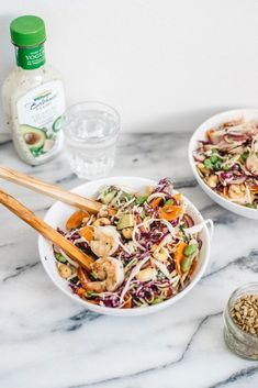 This filling Crunchy Asian Cabbage Salad with Shrimp has tons of fresh produce, seeds, and is topped with a creamy Cilantro Avocado dressing! Asian Cabbage Salad, Green Cabbage, Seafood Salad, Shrimp Salad, Fiesta Salad, Avocado Dressing, Summer Salad Recipes, Dinner Salads, Edamame
