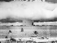 Underwater detonation of atomic bomb on Bikini Atoll in the Pacific to test the effect on sea vessels.  Notice the USS Arkansas standing on end on the right side of the explosion -1946.
