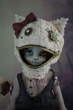 haveaquirkyday:  Cheshire Cat, Alice in Underland by dd-anne on Flickr. Here is the doll I mentioned before. She's just plain perfect and quirky and creepy and cute. I'm dying from the adorableness.  DD-Annes dolls are all amazing and the craftsmanship that goes into each one is incredible.  Shes also an utterly delightful person.  I have four of her dolls and I cannot possibly recommend her highly enough.