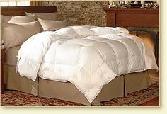 Deluxe Oversized Comforter - Pacific Coast Feather Company- I'm sleeping at the Ritz every night :)  ONLY down comforter that actually fills up the duvet cover corner to corner! And has great ties to keep it in place-NO shifting!