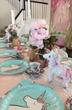 Unicorn themed tea party with a backdrop for all the princess girls to take a selfie in front of. Travelingtea.org Mobile tea parties