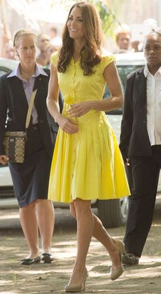 Sewing inspo: Kate in a bright yellow shirtdress with pleated skirt.
