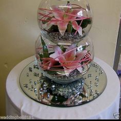 Lilly fishbowl table centres wedding