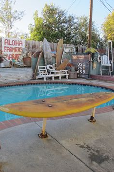 Surfboard bench. Mine has tikis for legs but this one would be nice to ...