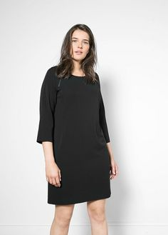 Shift dress with round neck. Decorative zips, three quarter raglan sleeves and inner lining.