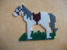 Horse hama beads by Nath Hour Melty Bead Patterns, Pearler Bead Patterns, Perler Patterns, Beading Patterns, Perler Bead Emoji, Perler Bead Disney, Perler Bead Art, Easy Perler Beads Ideas, Diy Perler Beads