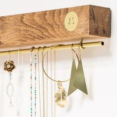 Personalised Oak And Brass Jewellery Stand. Discover thoughtful, personal and wonderfully unique jewellery gifts for her this Christmas