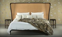 Contemporary double bed with headboard upholstered in leather